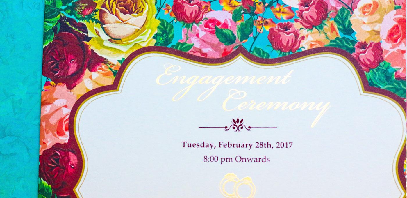 Indian elite wedding invitation designer studio teal mauve crimson floral border elite invitation card design that1card stopboris Images